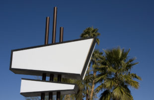 Quintessential Palm Springs -- a blank, white and black modernist sign in front of palm trees and a clear blue sky.  (Quintessential Palm Springs -- a blank, white and black modernist sign in front of palm trees and a clear blue sky. , ASCII, 117 comp